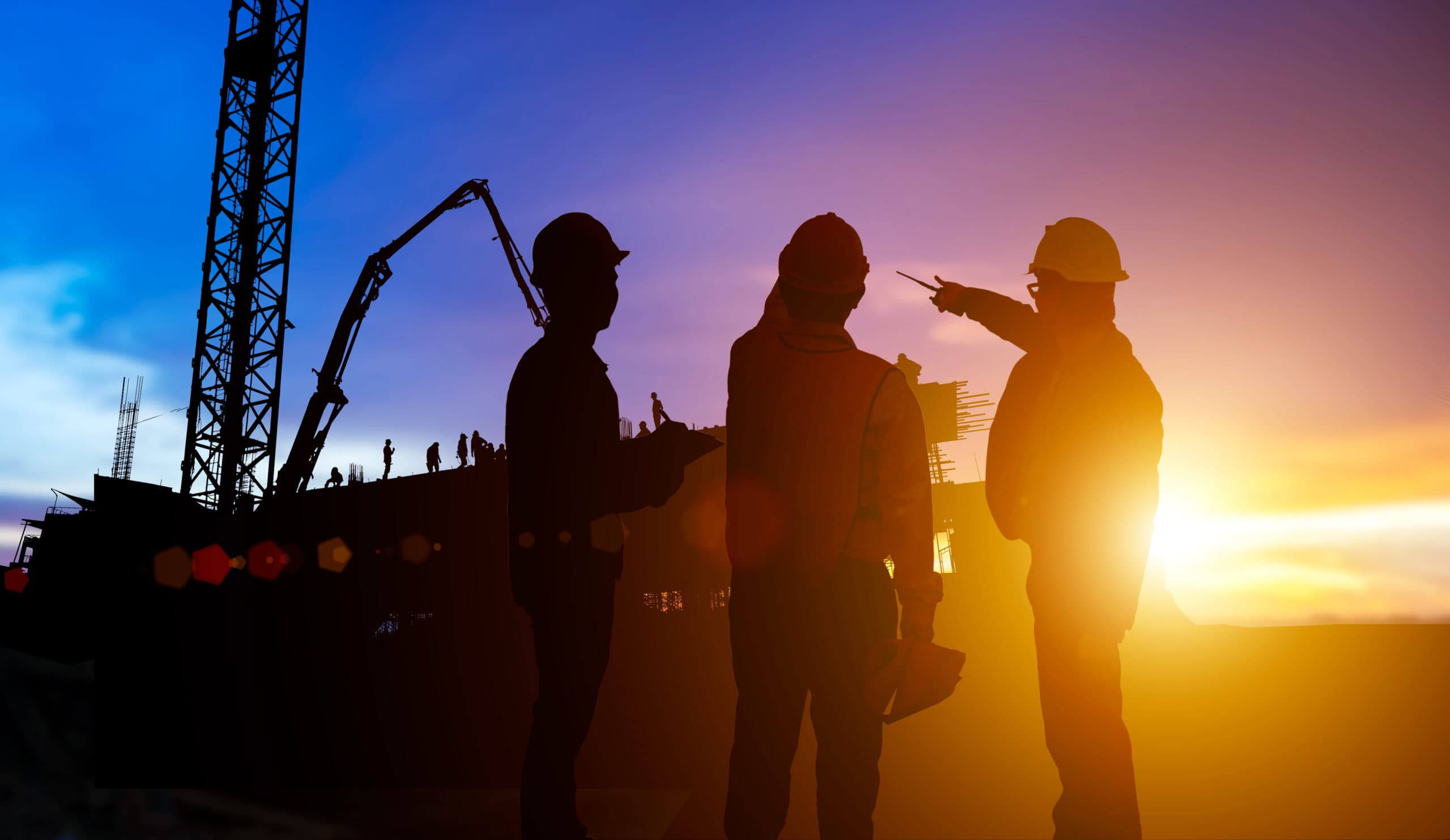 Silhouetteteams,Businessman,Engineer,Looking,Blueprint,In,A,Building,Site,Over